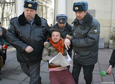 """Alexei Kiselyov was arrested by police for presenting a """"Gay Is Normal"""" sign publicly in St. Petersburg, Russia."""